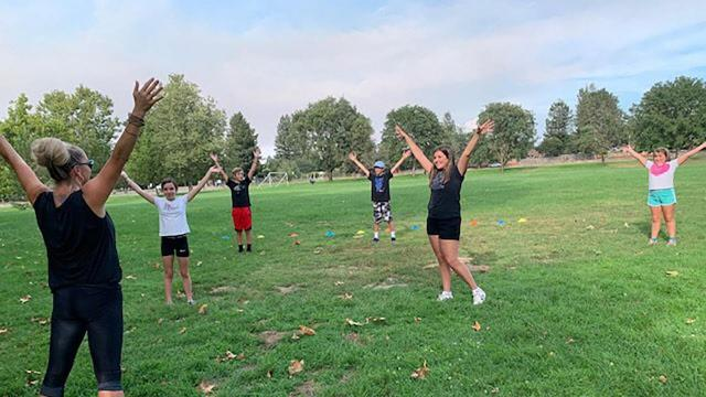 Fitness trainer Myriah Volk (far left) of Sebastopol, California, leads a socially distanced gym class through her PE Express 101 business.