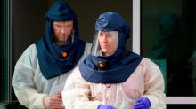 IMAGES: US should consider national mask mandate for the winter, former FDA commissioner writes in op-ed