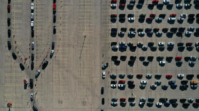 An aerial view of vehicles queuing at a drive-thru COVID-19 testing site at the Alliant Energy Center complex, as the coronavirus disease outbreak continues in Madison, Dane County, Wisconsin, U.S., November 5, 2020. Picture taken with a drone. REUTERS/Bing Guan     TPX IMAGES OF THE DAY