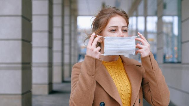 Photo of woman putting on a mask from pexels, via Anna Shvets