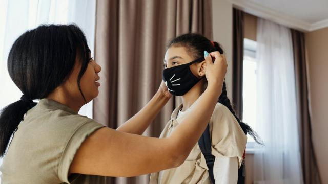 Mother putting mask on her daughter: August de Richelieu