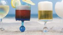 IMAGE: These Genius Wine Glasses Stick In The Sand And Float In The Pool