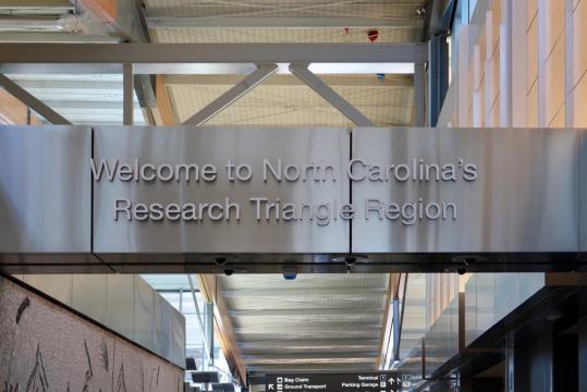 Sign at RDU International Airport welcomes visitors to the Triangle.