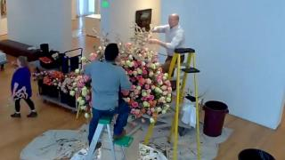 Timelapse: Flowers reflect art museum pieces