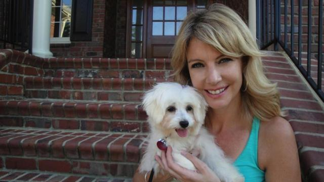 Anchor Jackie Hyland poses with her adorable Coton de Tulear, Sophie.