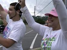 WRAL's Pam Saulsby and fellow Five Fighter Sean Ikaika Hamre stand along Glenwood Avenue in Raleigh to encourage drivers to honk for an end to breast cancer.