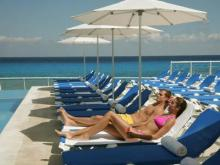 Tourists relax poolside -- and beachside -- on Cozumel off the coast of Cancun.
