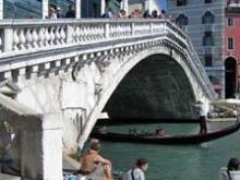 The Rialto Bridge over the Grand Canal is one of Venice's most elaborate and romantic bridges.