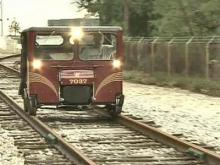 Man Rides Rails With Boxy Car, Not Boxcar