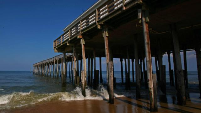 Small waves break against the supports of the Kitty Hawk pier.