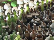 Bottle collector puts his stockpile to use