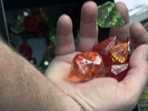 """Andy Smith, a geocaching fan and self-described geek, used his GPS item to find a """"treasure"""" in the woods."""