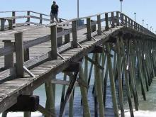 The Kure Beach Pier's history started with L. C. Kure, who built the first pier in 1923. His grandson, Mike, has owned the pier since 1984. The current Kure Beach Pier is 750-feet long and 22-feet wide. It stands 25-feet above the sea.