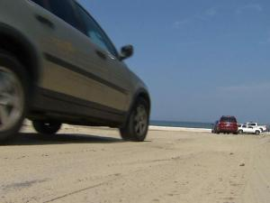 In the northern Outer Banks, the last asphalt of N.C. Highway 12 doesn't mark the end of the road, but the start of a 14-mile-long beach where wild horses and small communities hide among sand dunes and all the vehicles must have four-wheel drive.
