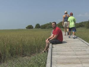 Television news photographer Dustin Etheridge (front, sitting) finds his peace on the Basin Trail in the Fort Fisher State Recreation Area.