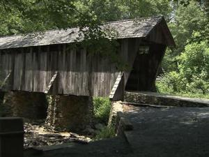 For a hundred years, travelers have passed over the Little River in Randolph County on a covered bridge. Today, the bridge draws families on vacation, enthusiastic builders and engaged couples taking photos.