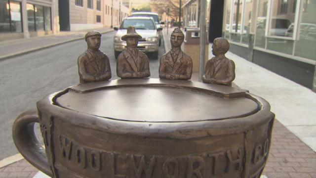 On Feb. 1, 1960, four black students sat at the all-white lunch counter at Woolworth's Department Store in Greensboro and asked for a cup of coffee. The answer was no, but the action helped catapult the Civil Rights Movement across the South. Eight artists honored their act of bravery with sculptures of coffee cups throughout downtown Greensboro, which were unveiled Wednesday.