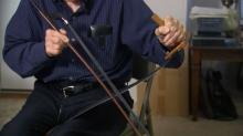 IMAGES: Butner man keeps dying art of saw music alive