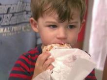 Boy eating doughnut