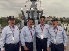 Barbershop quartet serenades battleship visitors