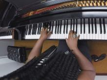 NCCU student 'living the dream' while playing piano