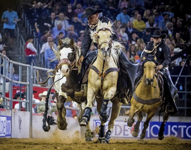 -- PHOTO MOVED IN ADVANCE AND NOT FOR USE - ONLINE OR IN PRINT - BEFORE FEB. 11, 2018. A saddle bronco riding event in 2017 in a photo provided by the Houston Livestock Show and Rodeo. If you love horses, barbecue, and live music, one of the world's largest livestock shows and rodeos, the Houston Livestock Show and Rodeo, is happening from Feb. 27 to March 18 at NRG Park. (Houston Livestock Show and Rodeo via The New York Times) -- NO SALES; FOR EDITORIAL USE ONLY WITH NYT STORY HOUSTON LIVESTOCK SHOW ADV11 BY SHIVANI VORA FOR FEB. 11, 2018. ALL OTHER USE PROHIBITED. --
