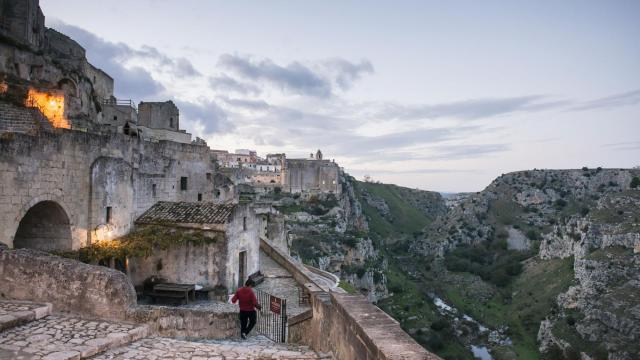 The city of Matera overlooks a ravine, in the Basilicata region of Italy, Nov. 22, 2017. The southern region of Basilicata, its people poor and its food and history rich, has been named Europe's Capital of Culture for 2019. (Susan Wright/The New York Times)