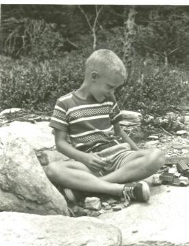 Bill Leslie playing as a child