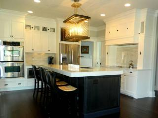 Photo courtesy of Kitchen & Bath Galleries. Kitchen Design by Bridgett Mazer Interiors.  As featured in our Fall issue, this kitchen was designed by Bridgett Mazer Interiors in collaboration with Kitchen & Bath Galleries.  We apologize for the omission of the credit to Bridgett Mazer Interiors.