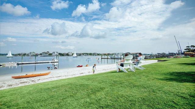 Visitors to Wrightsville Beach can enjoy stand-up paddle boarding, kayaking, or sailing on the Intracoastal Waterway.