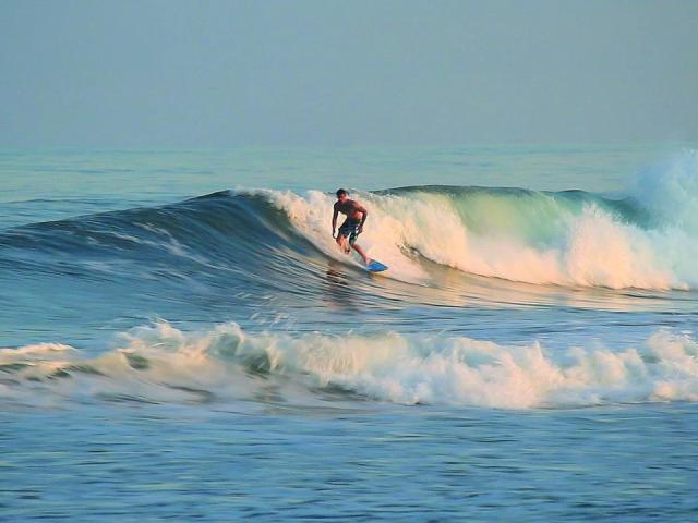 "Known as a pioneer in East Coast surfing since 1909, National Geographic named Wrightsville Beach among the world's best surf spots and one of the ""Last Best American Beach Towns."""