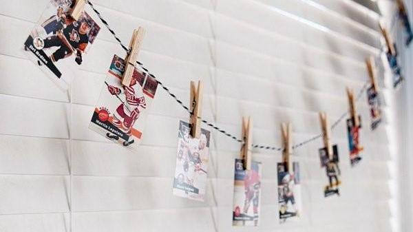 Liven up decor using clothespins to clip hockey playing cards on a long string; then drape the line across a window. (Photo Courtesy Hostess with the Mostess)