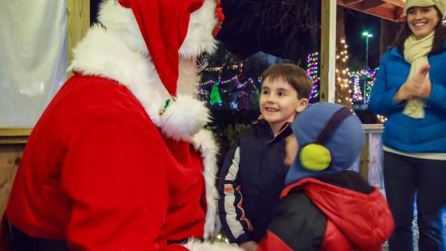 Attendees of Wilson Winter Lights in the Wilson Botanical Gardens can meet and take photos with Santa Claus himself. (Photo Courtesy of City of Wilson)