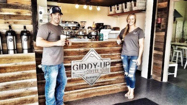 Loralyn Moore (right) and her husband, Trey (left), a native of Washington, N.C., renovated an old car garage into Giddy-Up Coffee House. (Photo Courtesy of Washington Tourism Development Authority)