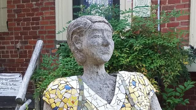 A sculpture of Norma Rae has sat in the courtyard outside Weaver Street Market at Carr Mill Mall in Carrboro since 2001. (Photo courtesy of Visit Chapel Hill)