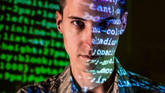 Tech Sgt. Kyle Hanslovan is a cyber-warfare specialist serving with the 175th Cyberspace Operations Group of the Maryland Air National Guard at Warfield Air National Guard Base, Middle River, Md. in this October 2017 photo. Hanslovan served on active duty with the Air Force for six years and then worked, in civilian life, as a cyber security contractor for the Department of Defense and now as the CEO of a cyber security start up firm. His continuing desire to serve his country led him to the Air National Guard, where he believes his civilian experience in defensive cyber-security greatly benefits his mission readiness for offensive cyber operations with the U.S. Air Force. (U.S. Air Force photo/J.M. Eddins Jr.)