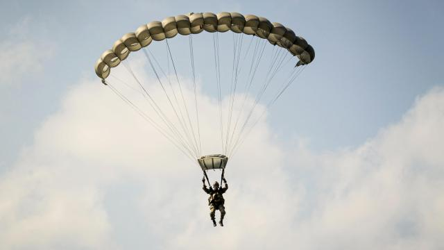 U.S. Marine Corps Sgt. Malcom Allen IV, a reconnaissance Marine with the Maritime Raid Force (MRF), 31st Marine Expeditionary Unit (MEU) parachutes over Ie Shima, Okinawa, Japan, Jan. 26, 2021. The MRF conducted high-altitude jumps and dropped joint precision air drop systems to maintain readiness for future exercises and operations. The 31st MEU is operating aboard ships of the America Expeditionary Strike Group in the 7th fleet area of operations to enhance interoperability with allies and partners and serve as a ready response force to defend peace and stability in the Indo-Pacific region. (U.S. Marine Corps photo by Cpl. Cody Rowe)