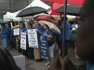 State employees rallied Tuesday against Gov. Beverly Perdue's plan to furlough workers to help balance the state budget.