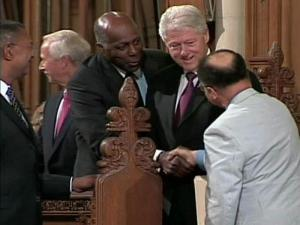 Civil rights leader Vernon Jordan, center, shakes hands with New York University history professor David Levering Lewis before a June 11, 2009, memorial service at Duke University for noted historian John Hope Franklin. Franklin's son, John Whittington Franklin, left, Duke President Richard Brodhead, second from left, and former President Bill Clinton, second from right, also spoke at the service.
