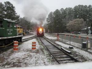Christmas Train #17 arriving at the Bonsal station while it is snowing on Saturday afternoon. www.nhvry.org