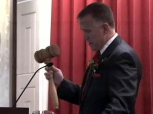 Newly elected House SPeaker Thom Tillis hold up a special gavel during the opening day of the 2011 legislative session on Jan. 26, 2011.