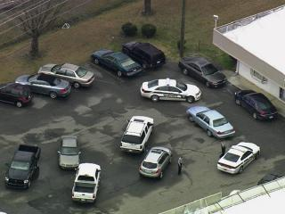 Wake County sheriff's deputies respond to a shopping center at 7633 Knightdale Blvd., on Jan. 30, 2013, where they searched a Jeep believed to be involved in a home invasion earlier in the day.