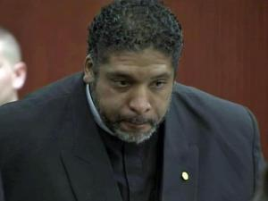 """NAACP President Rev. William Barber appears in court on Oct. 25, 2013, on a charge in connection with the """"Moral Monday"""" protests."""