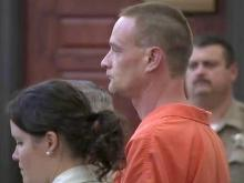 Suspect in Durham priest slaying appears in court