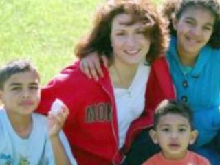 Christine Perolini with her children Alexis, Devon and Blake in an updated family photo.