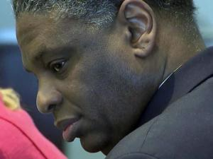 Joseph Mitchell listens to testimony on March 6, 2015, during his murder trial.