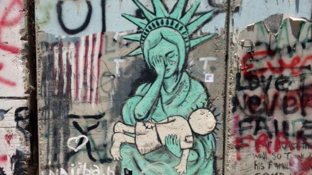 Graffiti mars the West Bank wall