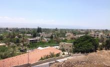 The contrast between Jewish and Palestinian areas of the West Bank is often evident in the presence of grass and desert.