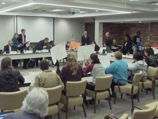 Protesters disrupt a UNC Board of Governors meeting on Jan. 26, 2016.