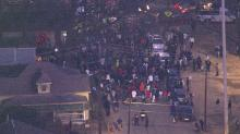 Officer-involved shooting protesters march down Wilmington Street